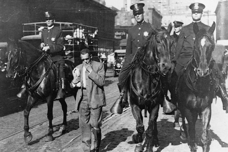 Mounted police round up black Americans and escort them to a safety zone during the Chicago race riot of 1919.