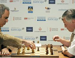 Garry Kasparov and Anatoli Karpov face off. Click image to expand.