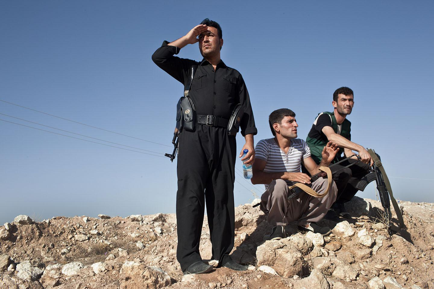 Kurdish military volunteers amass near the frontline on the outskirts of the town of Makhmor, 35 miles south of Irbil, the capital of the Kurdish Region of Iraq (KRI), on August 9, 2014.