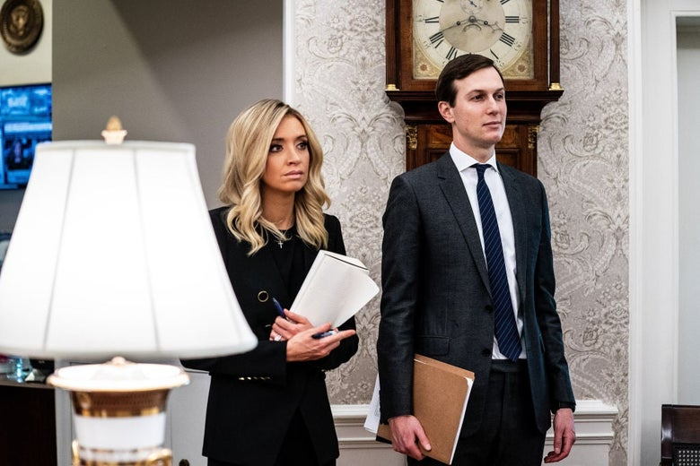 McEnany and Kushner stand side by side in front of a fancy old clock.