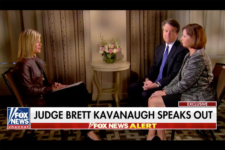 Brett Kavanaugh and his wife in a still from his interview.