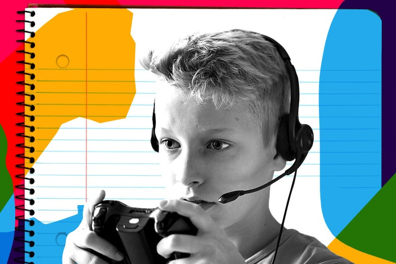 A boy focused intently on a video game, holding a controller and wearing a headset.