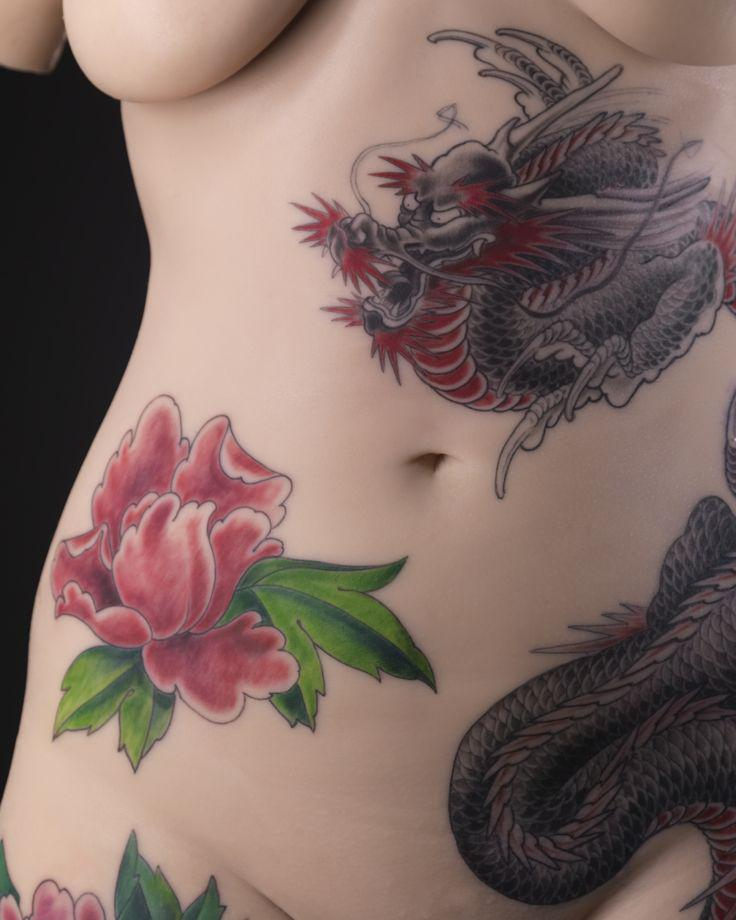 Tattoo motif designed by French tattoo artist Tin-tin on the silicone bust of a woman's body.