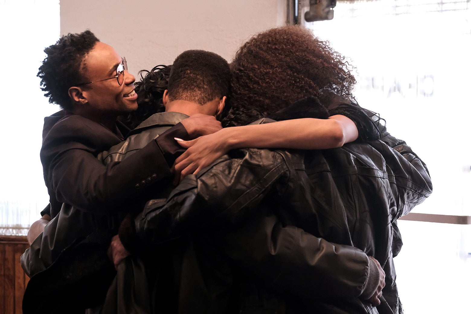 The characters engage in a group hug.