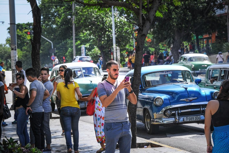 A man takes a picture with his mobile phone in Havana.