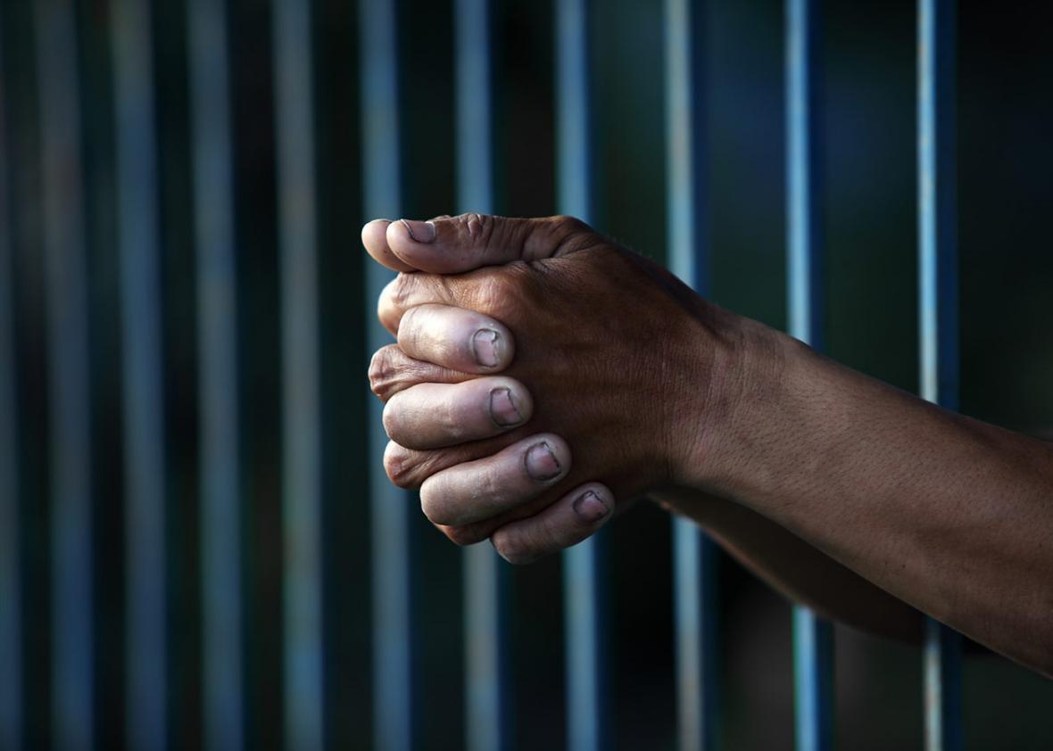 Man behind bars.