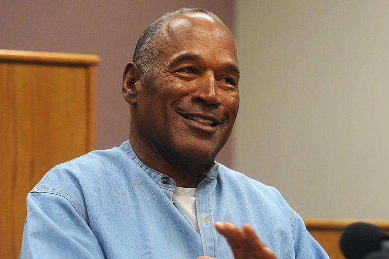 O.J. Simpson in a blue jumpsuit at a parole hearing.