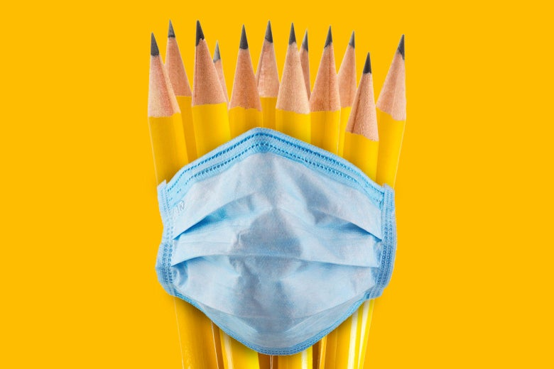A bunch of pencils banded together by the loop of a face mask.