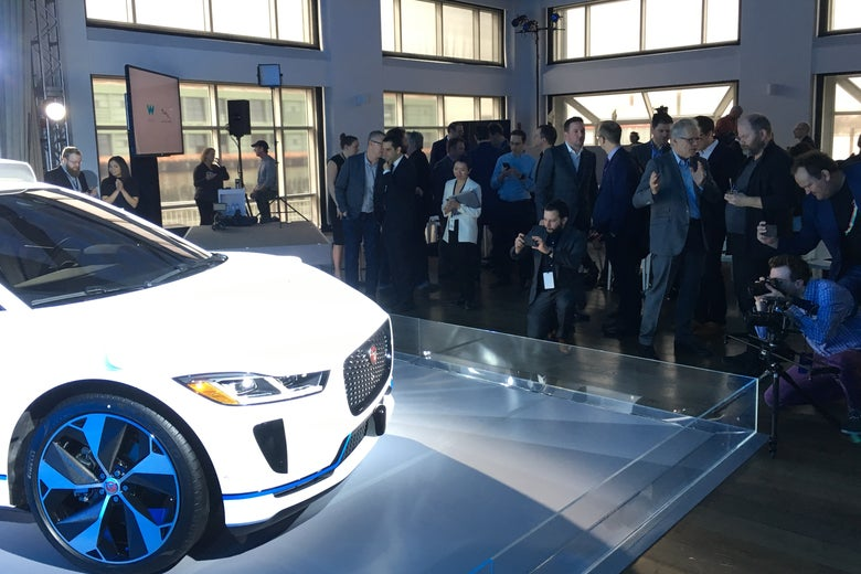 Journalists photograph a prototype of the self-driving, electric, Jaguar I-Pace at the Waymo launch event on Tuesday.