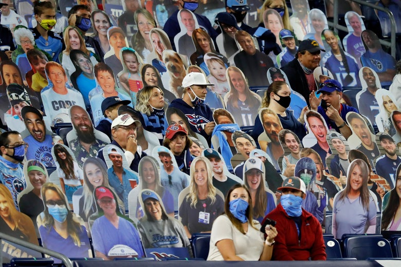 Fans sits among cardboard cutouts during the game between the Buffalo Bills and Tennessee Titans at Nissan Stadium on October 13, 2020 in Nashville, Tennessee.