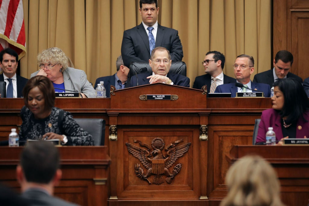 Nadler is seated at the center of two rows of daises occupied by other members of the House.