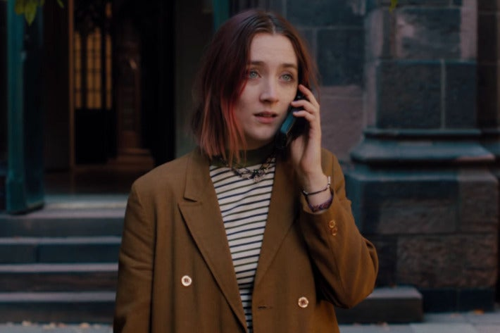 Saoirse Ronan as Lady Bird, holding a cell phone to her ear