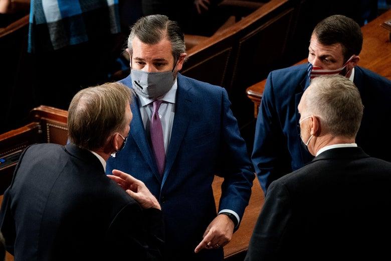 A masked Sen. Cruz chats it up.