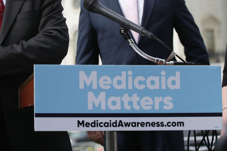 "A sign on a podium says, ""Medicaid Matters."""