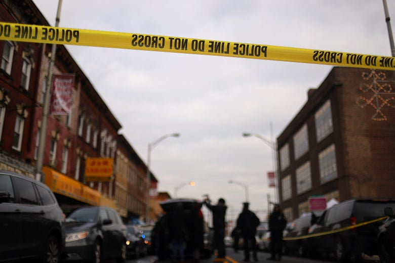 Detail of a police line band as recovery and clean up crews arrive to the JC Kosher Supermarket in the aftermath of a mass shooting on December 11, 2019 in Jersey City, New Jersey.