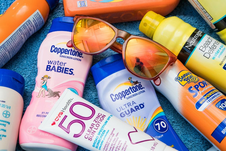 variety of sunscreens and a pair of sunglasses
