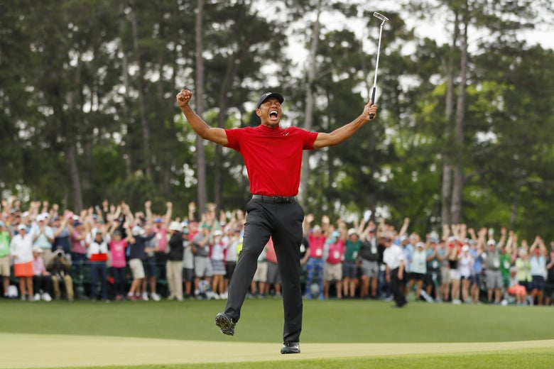 Tiger Woods  celebrates after sinking his putt on the 18th green to win the Masters, at Augusta National Golf Club on April 14.