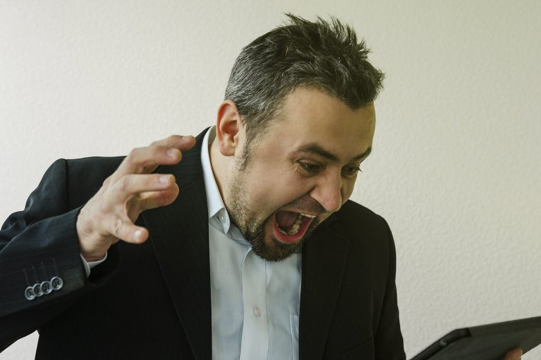 Man yelling with a tablet computer.