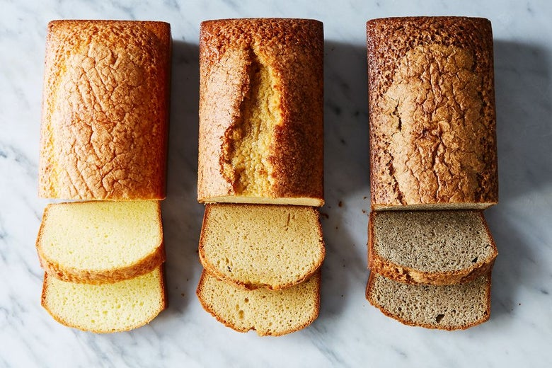Three loaves of pound cake with the ends sliced off, in three different shades, from bright yellow to brown.