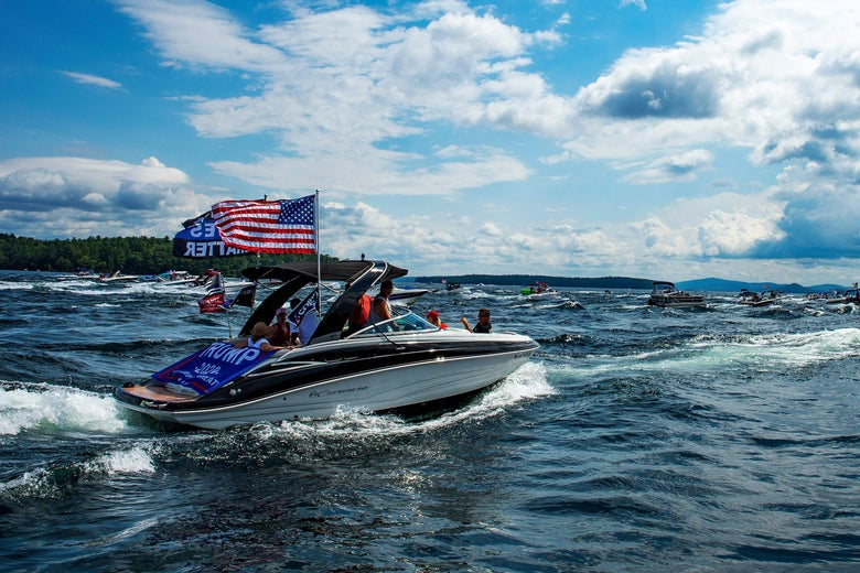 Hundreds of boats decorated with President Donald Trump campaign flags parade through Lake Winnipesaukee in Laconia, New Hampshire on August 22, 2020.
