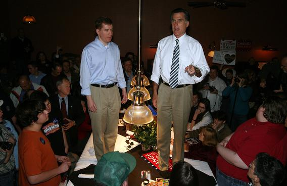 Standing on a pool table along side of Mo. Gov. Matt Blunt, republican presidential hopeful Mitt Romney (R) addresses supporters during a campaign stop at a Dave and Buster's Restaurant in Maryland Heights,