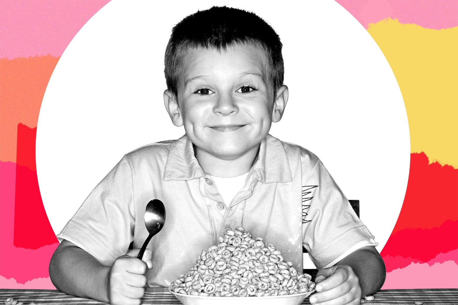 A young boy with a bowl of cereal.