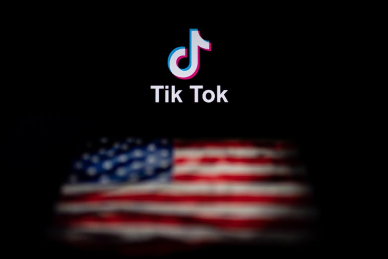 Two laptop screens with different images on them. The TikTok logo is on the first screen. The American flag is on the other.