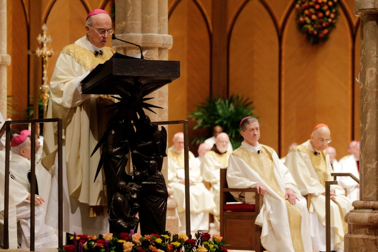 Archbishop Carlo Maria Vigano, Apostolic Nuncio of the United States, reads the Apostolic Mandate during the Installation Mass of Archbishop Blase Cupich at Holy Name Cathedral in Chicago November 18, 2014.