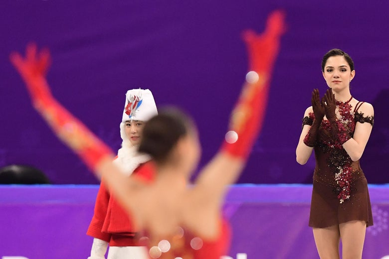 Gold medallist Russia's Alina Zagitova celebrates (L) as silver medallist Russia's Evgenia Medvedeva claps before the venue ceremony after the women's single skating free skating of the figure skating event during the Pyeongchang 2018 Winter Olympic Games at the Gangneung Ice Arena in Gangneung on February 23, 2018.