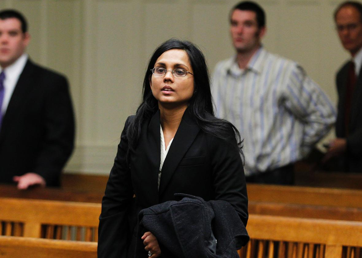 Annie Dookhan, a former chemist at the Hinton State Laboratory Institute, listens to the judge during her arraignment at Brockton Superior Court in Brockton, Massachusetts January 30, 2013.