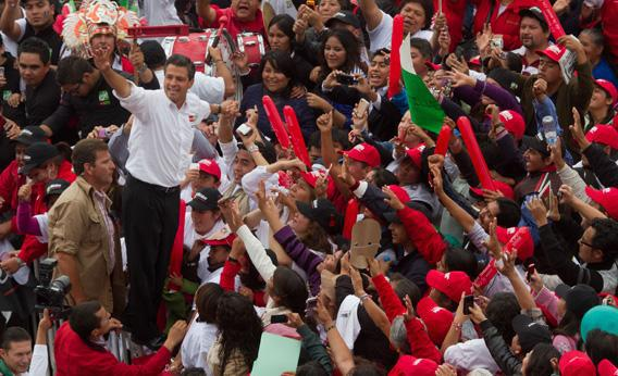 The presidential candidate for Mexico's Institutional Revolutionary Party (PRI), Enrique Peña Nieto, waves at supporters during an electoral rally in Toluca, Mexico State, on June 27, 2012.