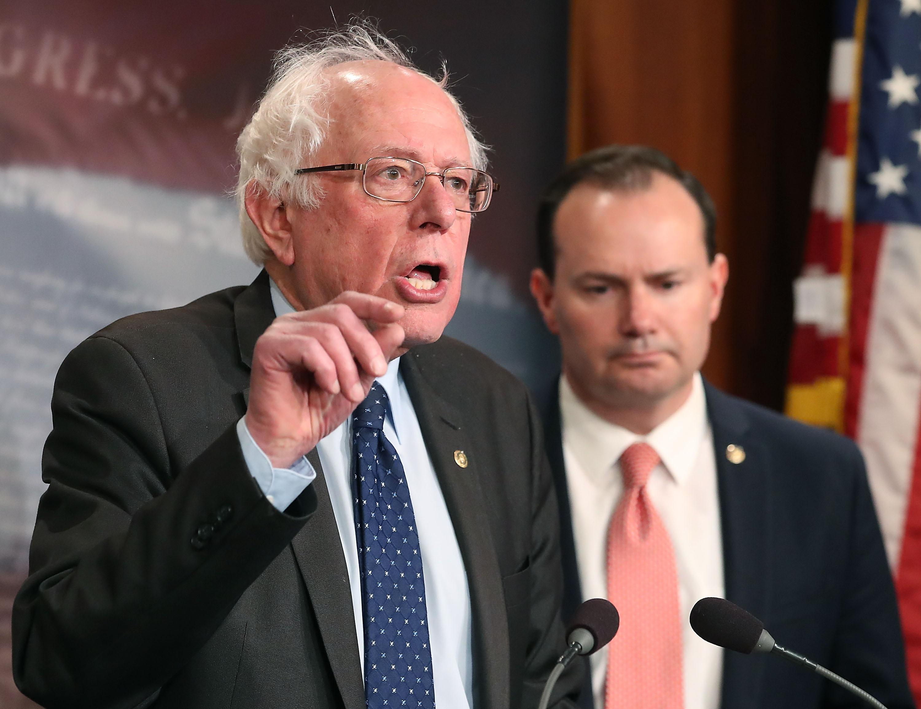 WASHINGTON, DC - MARCH 01: Sen. Bernie Sanders (I-VT), (L), and Sen. Mike Lee (R-UT), introduce a joint resolution to remove U.S. armed forces from hostilities between the Saudi-led coalition and the Houthis in Yemen, on Capitol Hill February 28, 2018 in Washington, DC.  (Photo by Mark Wilson/Getty Images)