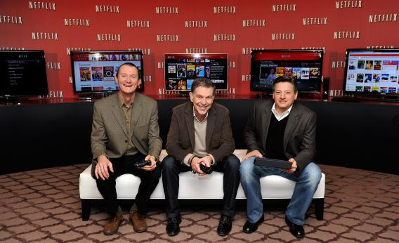 Neil Hunt, chief product officer at Netflix; Reed Hastings, co-founder and of Netflix; and Ted Sarandos, chief content officer of Netflix, pose during the Netflix U.K. launch in London, Jan. 9, 2012.