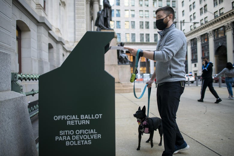 A voter casts his early voting ballot at drop box outside of City Hall on October 17, 2020 in Philadelphia, Pennsylvania.  With the election only a little more than two weeks away, a new form of in-person early voting by using mail ballots, has enabled millions of voters to already cast their ballots.  President Donald Trump won the battleground state of Pennsylvania by only 44,000 votes in 2016, the first Republican to do so since President George Bush in 1988.  (Photo by Mark Makela/Getty Images)
