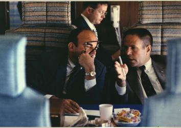 Presidential advisers, H.R. Haldeman and John D. Ehrlichman discuss policy aboard Air Force One over the Mississippi flooded area near Merideth, Mississippi, April 1973.