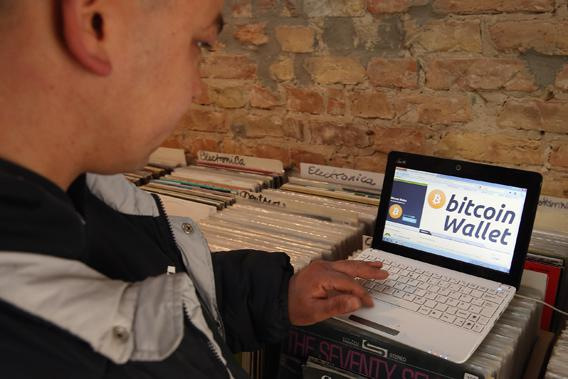 The proprietor of a shop selling vinyl records and that accepts Bitcoins for payment brings up, at the request of the photographer, the Bitcoins website on the proprietor's computer on April 11, 2013 in Berlin, Germany.