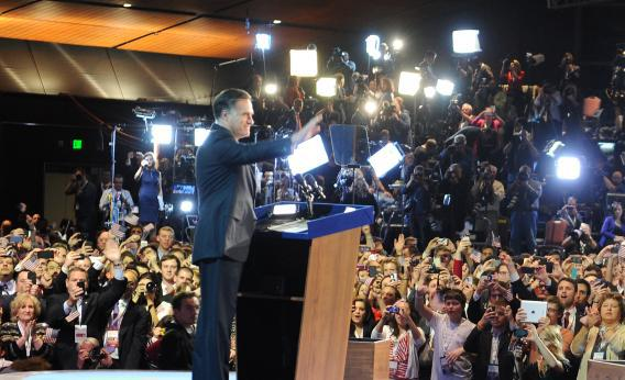 Mitt Romney greets supporters as he concedes the presidency during his campaign election.