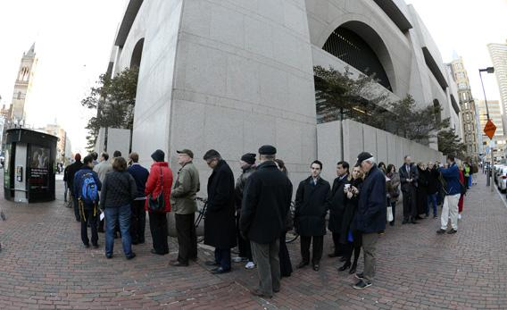 Voters line up to cast their vote in Boston