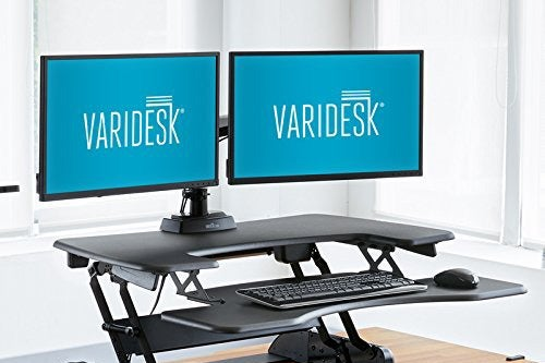 Two screens on an adjustable standing desk.