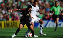 Javier Hernandez of Mexico is pressured by Jermaine Jones of the United States. Click image to expand.