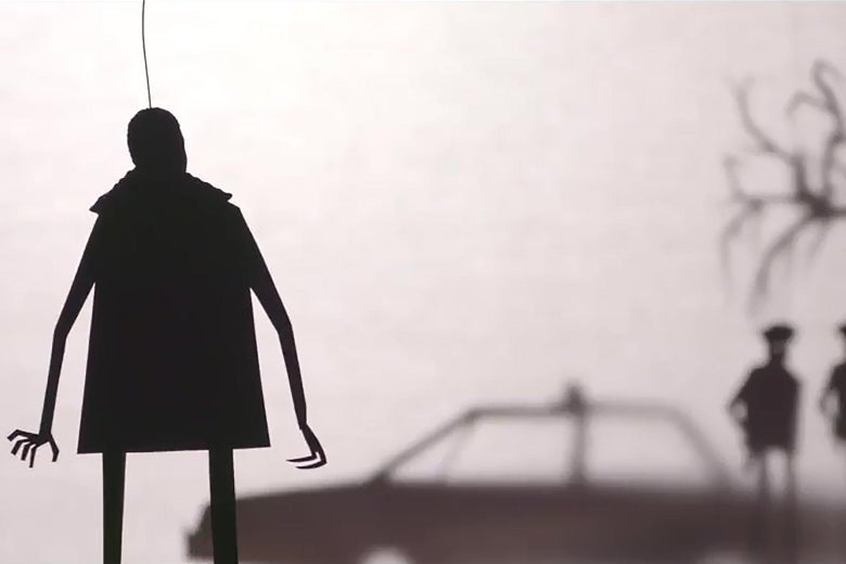 A shadow puppet silhouette of a man is in the foreground; his right hand is deformed. In the distance, police officers stand around a cruiser.