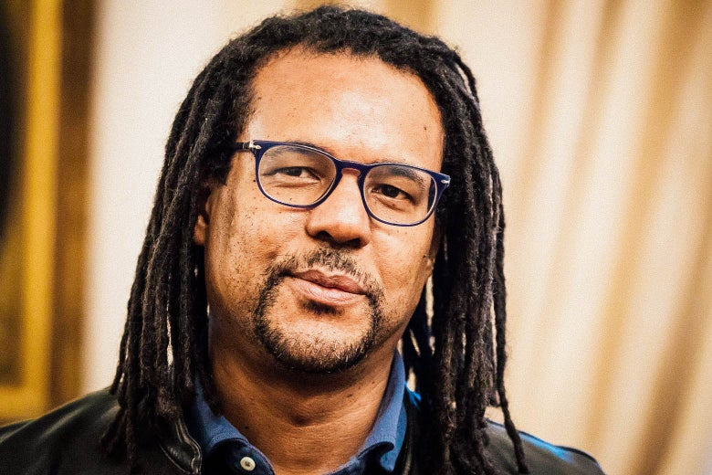 A Black man with dreadlocks and glasses.