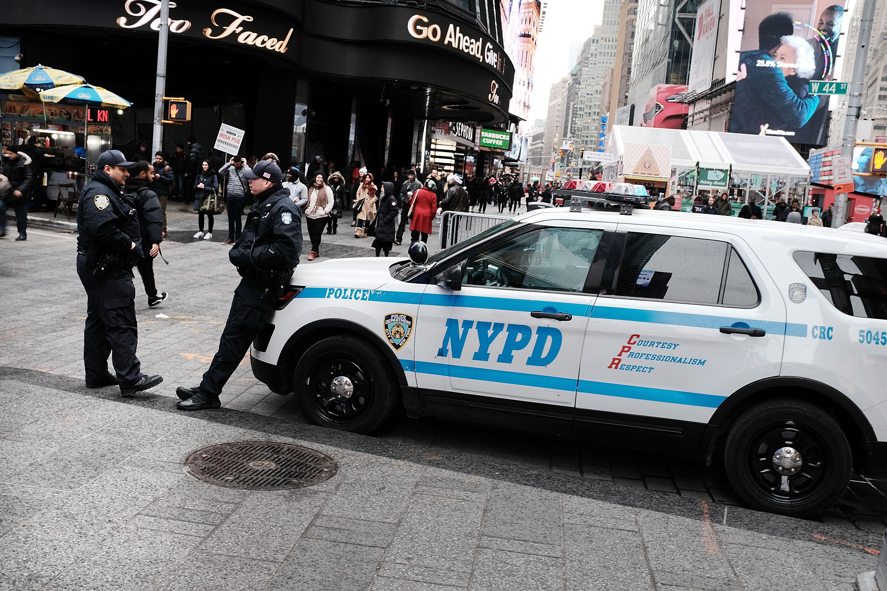 New York City police stand on a corner in Times Square on December 12, 2017 in New York City.