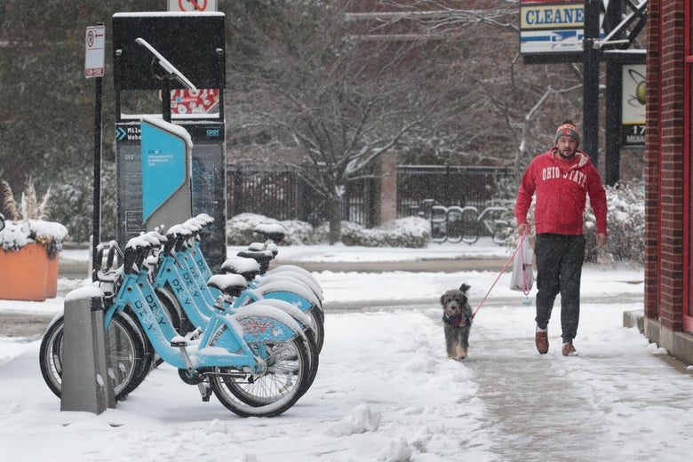 CHICAGO, ILLINOIS - NOVEMBER 11: Snow covers bicycles in the Bucktown neighborhood on November 11, 2019 in Chicago, Illinois. Forecasters are calling for three to six inches of snow to fall in the Chicago area by mid-day today and temperatures are expected to fall to around ten degrees Fahrenheit by tomorrow.  (Photo by Scott Olson/Getty Images)