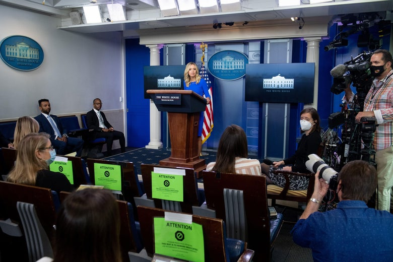 Kayleigh McEnany stands at a podium, holding a press briefing in the Brady Press Briefing Room of the White House.