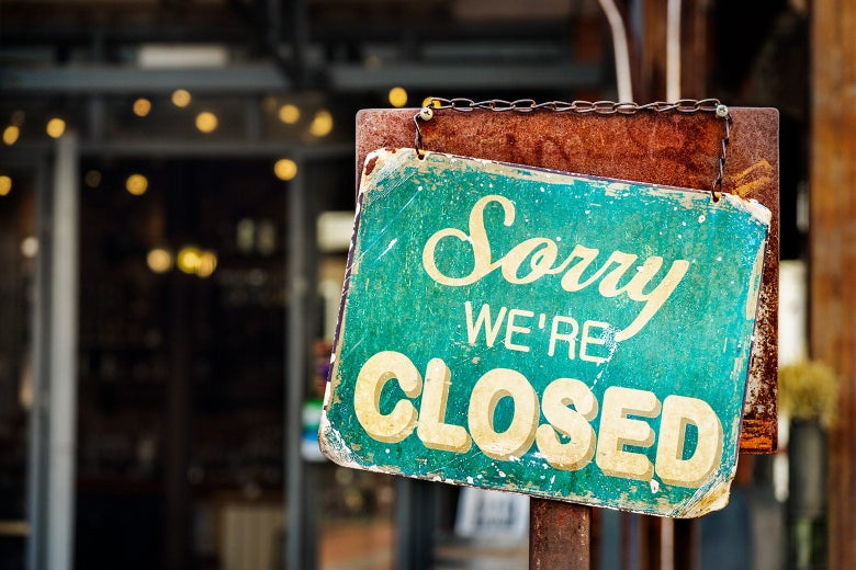 "A sign says, ""Sorry, we're closed."""