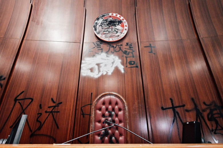 Graffiti is seen in the main chamber of the Legislative Council in Hong Kong.