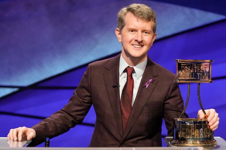 Ken Jennings with the Greatest of All Time Jeopardy trophy.