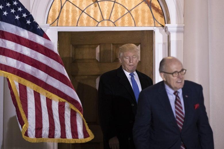 Donald Trump walking behind Rudy Giuliani.