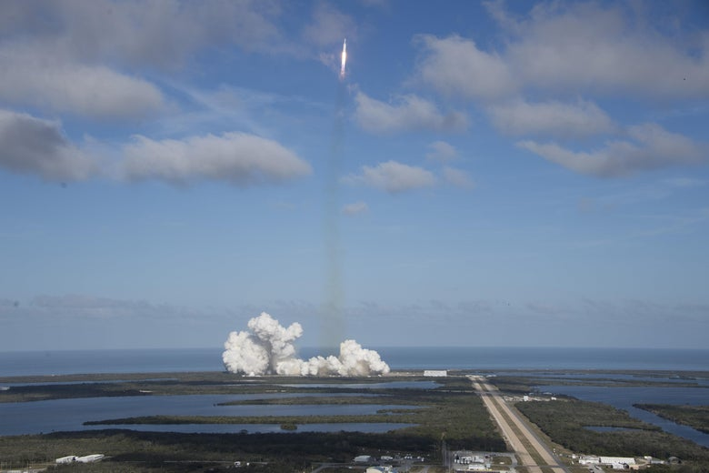 The SpaceX Falcon Heavy launches from Pad 39A at the Kennedy Space Center in Florida, on February 6, 2018, on its demonstration mission. The world's most powerful rocket, SpaceX's Falcon Heavy, blasted off Tuesday on its highly anticipated maiden test flight, carrying CEO Elon Musk's cherry red Tesla roadster to an orbit near Mars. Screams and cheers erupted at Cape Canaveral, Florida as the massive rocket fired its 27 engines and rumbled into the blue sky over the same NASA launchpad that served as a base for the US missions to Moon four decades ago.  / AFP PHOTO / JIM WATSON        (Photo credit should read JIM WATSON/AFP/Getty Images)